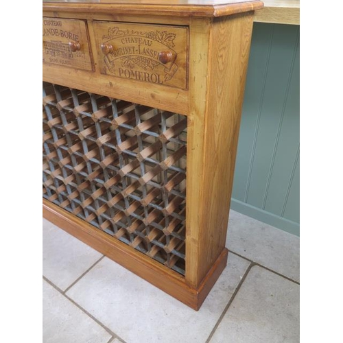 14 - A new pine 70 bottle wine rack with three wine box fronted drawers made by a local craftsman to a hi...