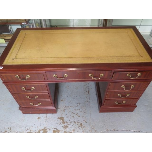 19 - A good quality Victorian style eight drawer mahogany twin pedestal desk with a leather insert top an...