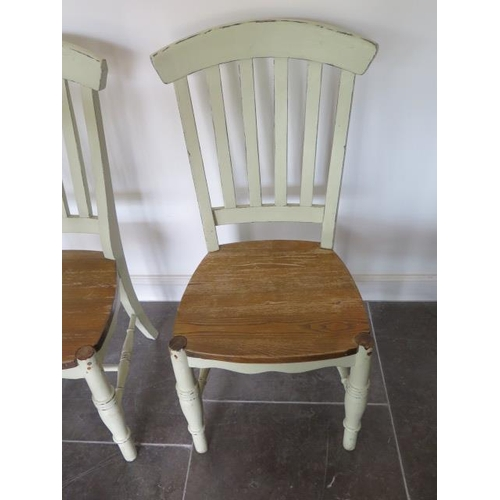20 - Four green painted shabby chic dining chairs, 104cm tall