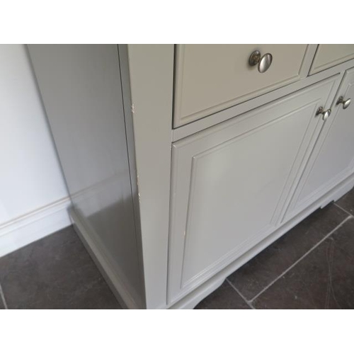21 - An ex-Bramblecrest grey painted two door cupboard with three frieze slow close drawers and oak top, ...