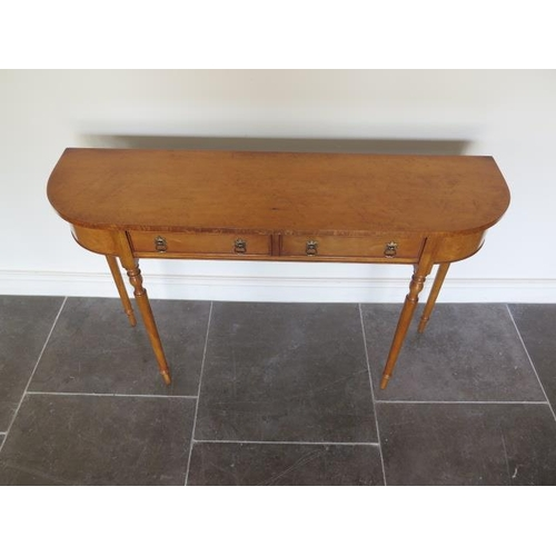23 - A new maple two drawer D shaped side hall table on turned legs made by a local craftsman to a high s...