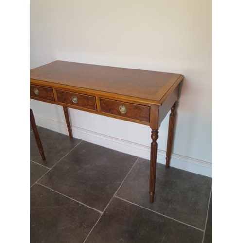 24 - A new walnut three drawer hall table on turned reeded legs made by a local craftsman to a high stand...