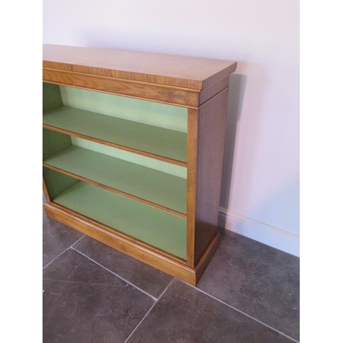 25 - A new burr oak bookcase with a painted interior having two adjustable shelves made by a local crafts...