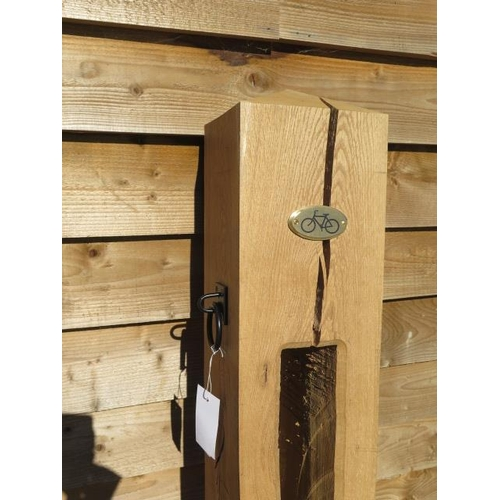 33 - A new green oak bicycle lock post, 157cm tall x 19cm x 19cm with plaque and ring plate, please note ...