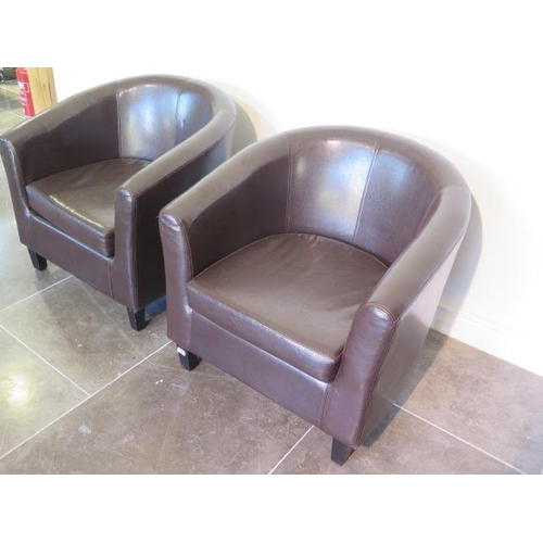 36 - A pair of modern brown faux leather tub chairs, 73cm tall