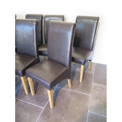 37 - A set of eight modern brown faux leather effect high back dining chairs, 107cm tall