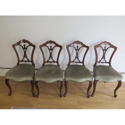 61 - A set of four Victorian walnut side chairs with upholstered seats on cabriole shaped front legs, all...