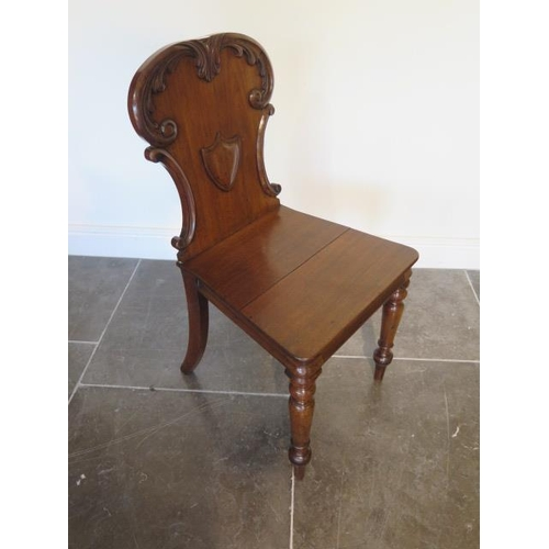 65 - A late Victorian mahogany hall chair in polished condition