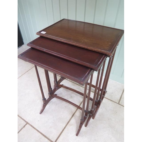 68 - A nest of three mahogany side tables 68cm tall x 51cm x 34cm, repair to two legs otherwise generally...