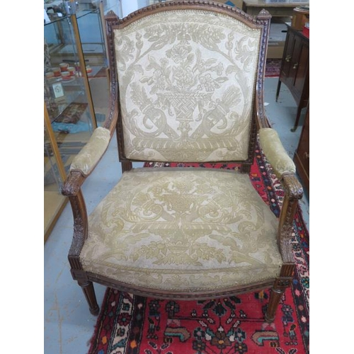70 - A 19th century carved walnut upholstered open armchair, 108cm tall x 75cm wide x 70cm deep, some wea...