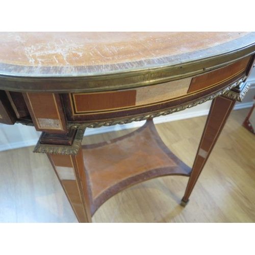 73 - A French style parquetry top oval side table with two drawers and oval mounts, some veneer losses bu...