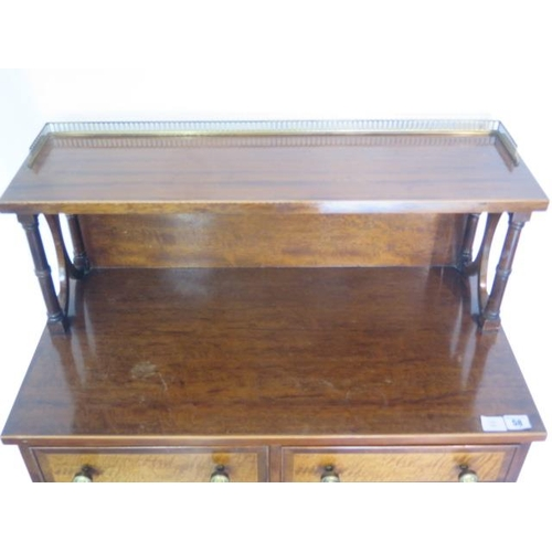 58 - A Regency style mahogany side cabinet with a gallery top and two drawers over two cupboard drawers, ...