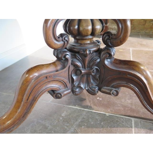 63 - A good Victorian rosewood marquetry inlaid circular breakfast table on an ornate carved triform scro...
