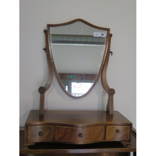 66 - A mahogany shield shaped dressing table mirror with three small drawers, 55cm tall x 46cm wide