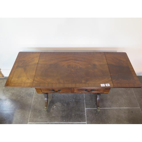 2 - A mahogany dropleaf coffee table with two small drawers, 51cm tall x 129cm extended by 41cm