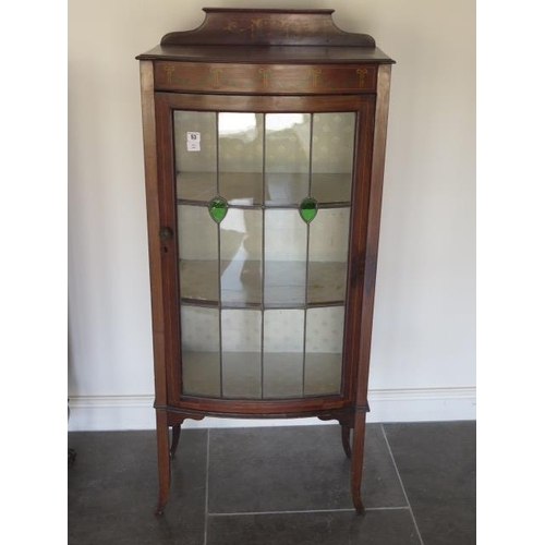 53 - An Edwardian decorated mahogany display cabinet with a bow fronted leaded glazed door, 139cm tall x ...