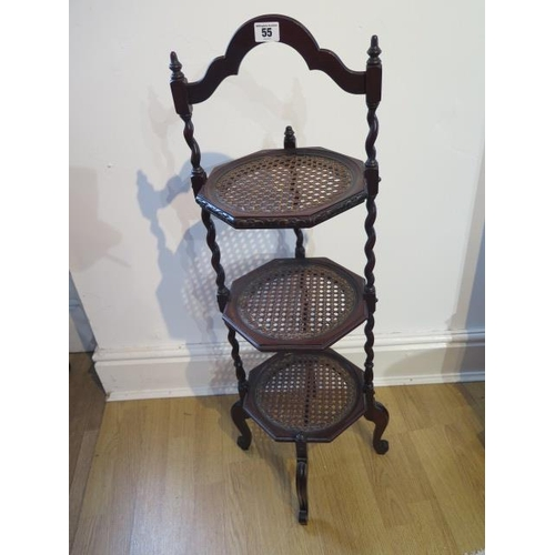 55 - A three tier mahogany and cane cake stand, 92cm tall, in good condition