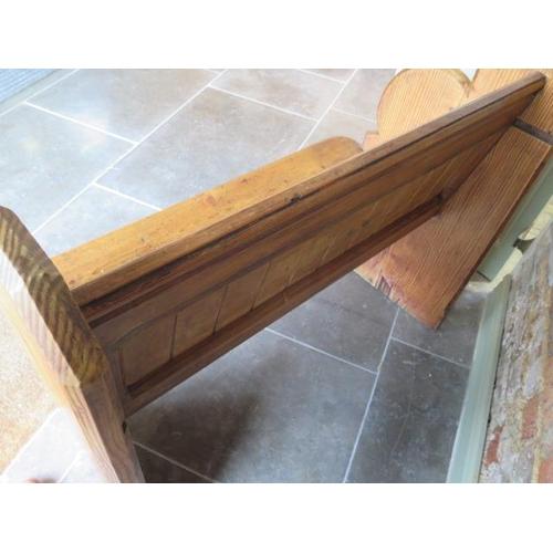 57 - A pitch pine pew hall bench, 89cm tall x 100cm wide x 53cm deep