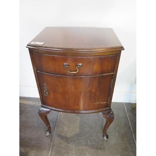 60 - A walnut bow fronted bedside cupboard, 72cm tall x 45cm x 37cm
