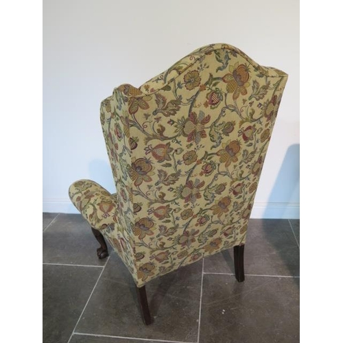 70 - A good reupholstered wing back armchair on ball and claw feet in good condition, 124cm tall x 94cm w...