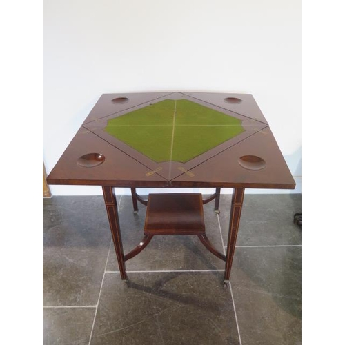 71 - An Edwardian mahogany envelope fold over card table with a frieze drawer, 73cm tall x 54cm x 54cm cl...