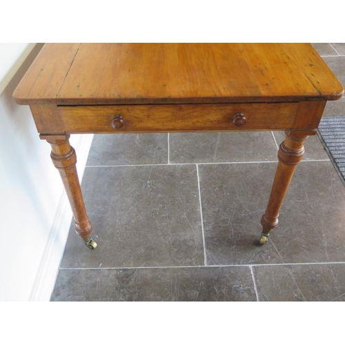 76 - A 19th century satinwood table with two long drawers both stamped Holland and Sons with a later pine...