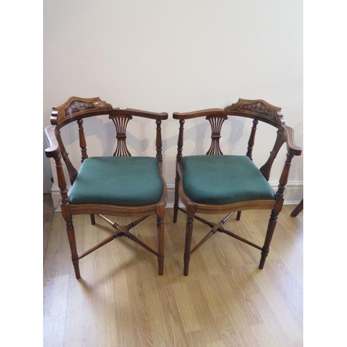 82 - A pair of Edwardian inlaid mahogany corner chairs both in generally good condition with reupholstere...