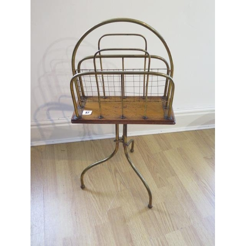 87 - An Edwardian oak, brass and wire work magazine stand, 74cm tall, in generally good condition