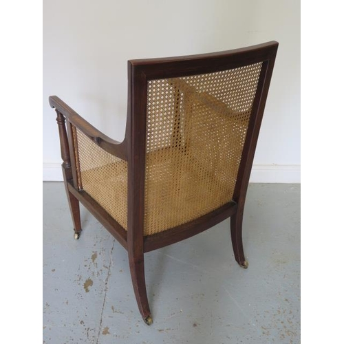 92 - An Edwardian inlaid mahogany beregere library chair with buttoned cushions on square tapering legs t...