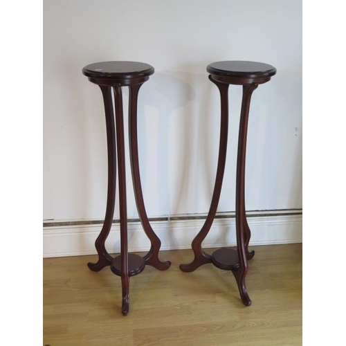 11 - A pair of Art Noveau style jardinere stands, each with an under tier, 109cm tall, tops 29cm diameter...