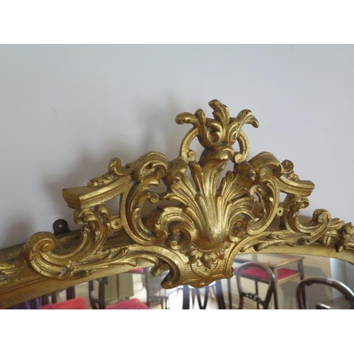 12 - An ornate gilt Victorian style over mantle mirror, 154cm tall x 136cm wide, in good condition