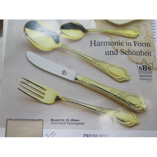 22 - A Bestecke SBS Solingen 12 setting gold plated canteen of cutlery in a briefcase, canteen all good c...