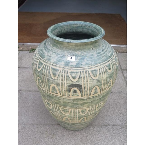 4 - A decorative terracotta planter, 56cm tall