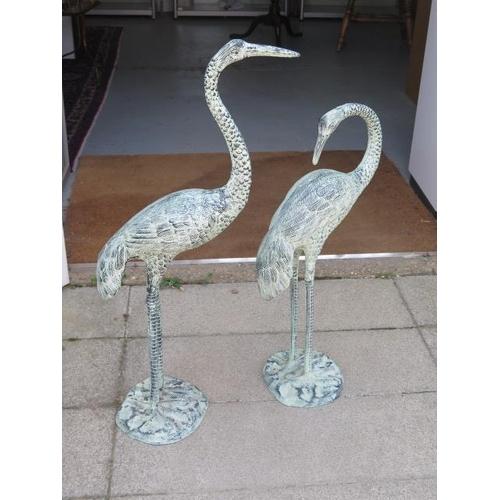 5 - A pair of decorative metal verdi gris effect Herons, tallest 95cm