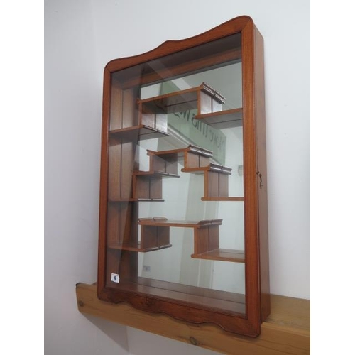 6 - A mirror backed wall mounting display cabinet with glazed door, 77cm x 51cm x 9cm, in good condition