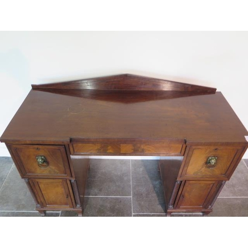 64 - A 19th century mahogany twin pedestal sideboard with three drawers and two cupboard doors, 104cm tal...