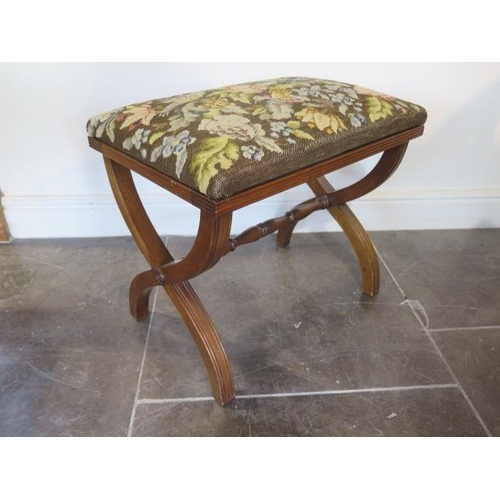 67 - A mahogany cross frame stool with a needlepoint seat, 45cm tall x 52cm x 36cm
