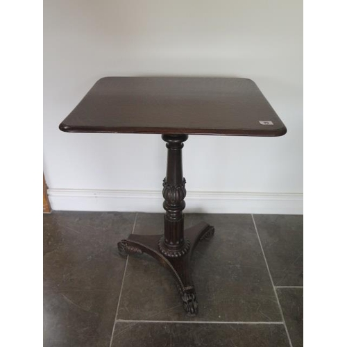 75 - An early 19th century oak side table on a carved turned column and tripartite platform base, 74cm ta...