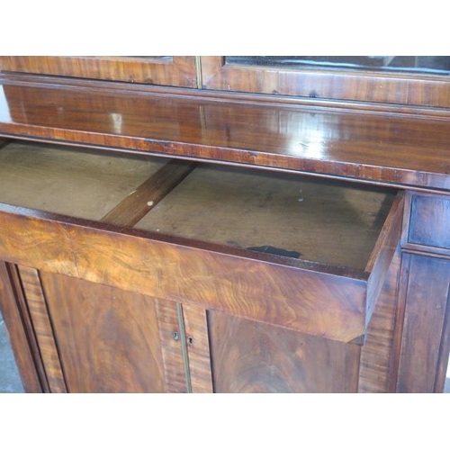 78 - A 19th century flame mahogany cupboard bookcase with two glazed doors over a drawer and two cupboard...