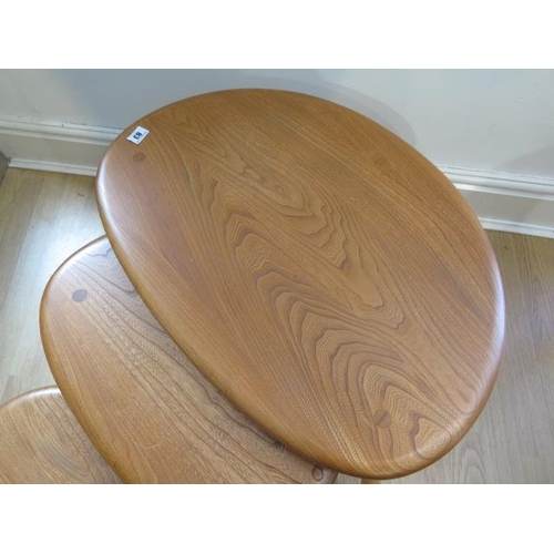 83 - A nest of three Ercol ash blonde pebble tables, 41cm tall x 66cm x 44cm, some small usage marks but ...