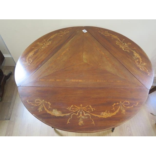 84 - An Edwardian inlaid mahogany dropleaf side table on shaped legs united by an undertier, some wear co...