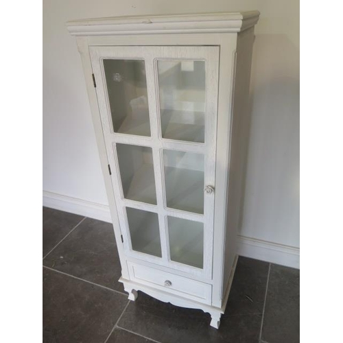 9 - A white painted glazed cabinet with a drawer, 121cm taqll x 49cm x 33cm