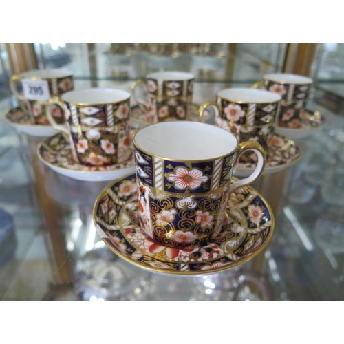 295 - Six Royal Crown Derby Imari 2451 coffee cans and saucers, all good condition apart from one saucer i...