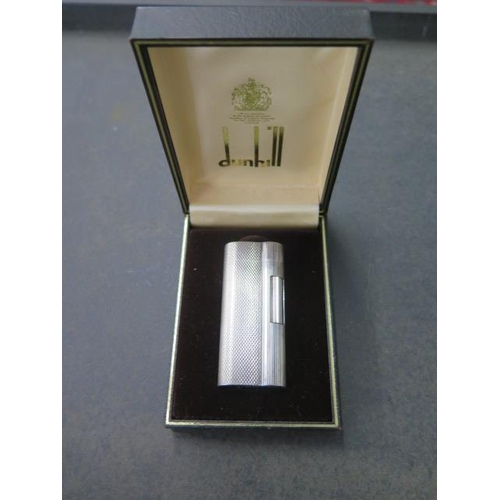 301 - A Dunhill silver plated lighter, C83208, in original case, generally good, not working