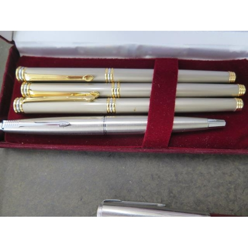 302 - A collection of 11 ink pens, including two Parker cartridge pens