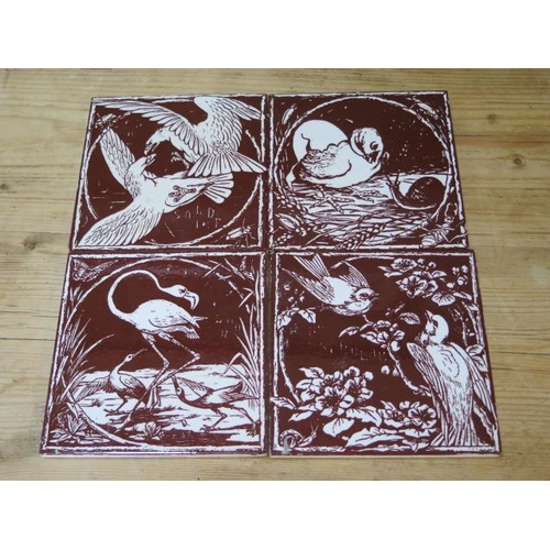 303 - Four Mintons China works bird brown and cream tiles, 15cm x 15cm, some crazing and small chips but g...