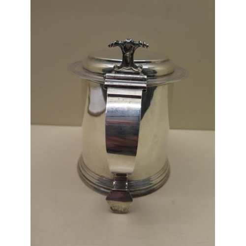 510 - A silver lidded tankard, Birmingham 1908/09, S & B, 18cm tall, no engraving, approx 29 troy oz, in g...