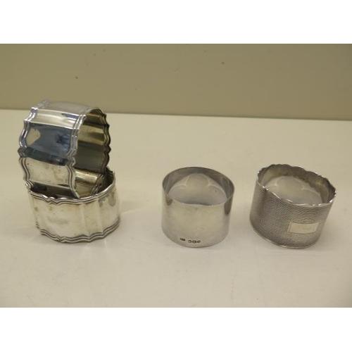 516 - Four silver serviette rings, approx 4.45 troy oz