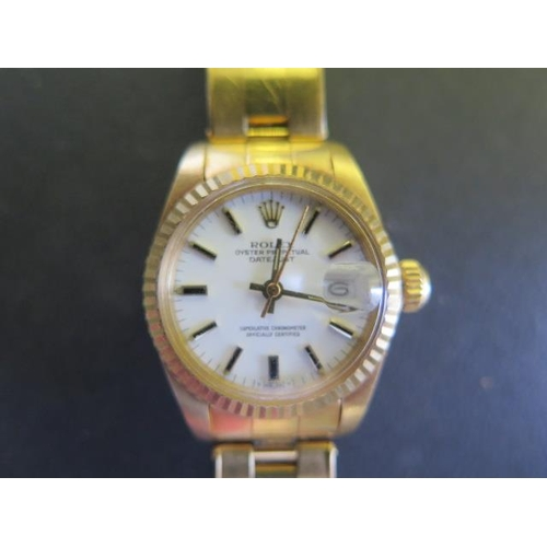 801 - A ladies 18ct yellow gold Rolex Oyster Perpetual Datejust bracelet wristwatch with white dial and ba...