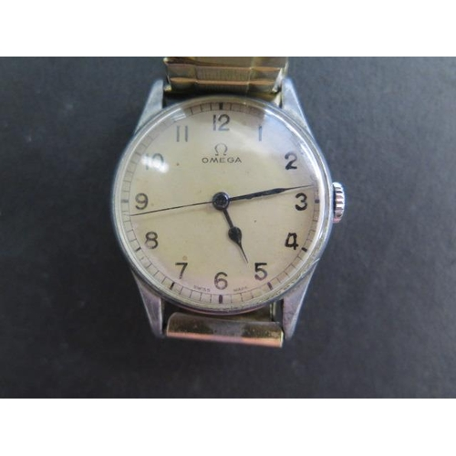 803 - A Gents military manual wind Omega wristwatch, 32mm case, marked 6B/159 A11551, in running order, ha...